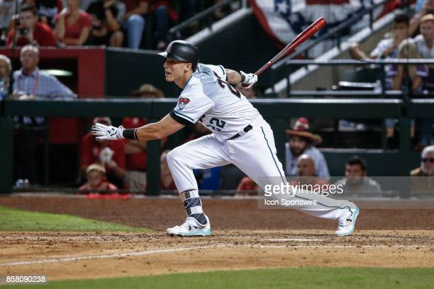 Arizona Diamondbacks third baseman Jake Lamb runs to first base during the MLB National League Wild Card baseball game between the Colorado Rockies...