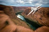 USA, Arizona, FA-18 Hornet flying over Colorado River