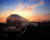 USA, Arizona, fuel tanker truck at sunset