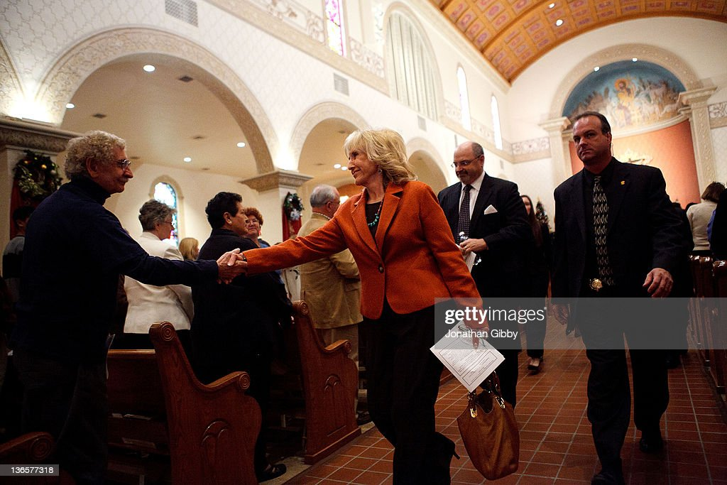 Arizona Governor <a gi-track='captionPersonalityLinkClicked' href=/galleries/search?phrase=Jan+Brewer&family=editorial&specificpeople=5513137 ng-click='$event.stopPropagation()'>Jan Brewer</a> greets an attendee after an interfaith memorial service held at St. Augustine Cathedral January 8, 2012 in Tucson, Arizona. Memorial services will be held throughout the day in Tucson to commemorate the one year anniversary of a shooting rampage that killed six people and wounded more than a dozen more including U.S. Rep. Gabrielle Giffords (D-AZ).
