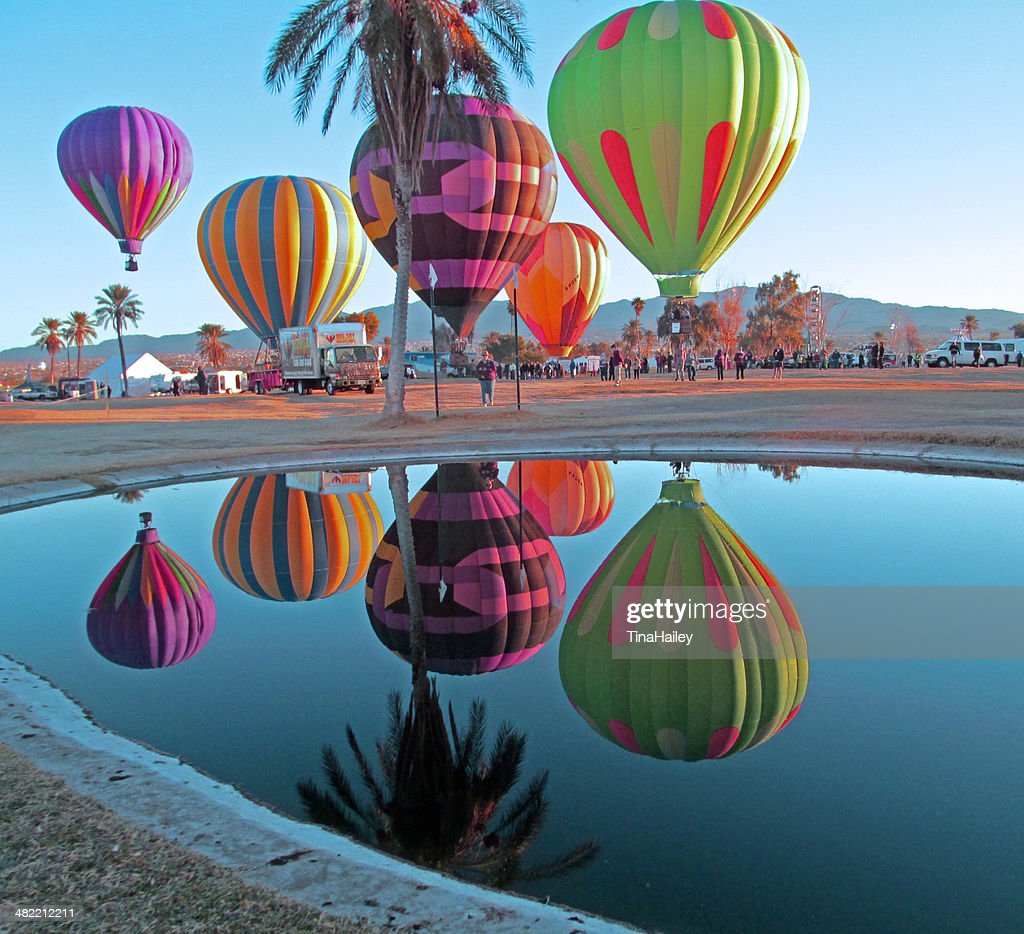 USA, Arizona, Mohave County, Lake Havasu City, Beachcomber Boulevard, Lake Havasu, Lake Havasu Balloon Festival, Hot Air Balloons reflected in pond : Stock Photo