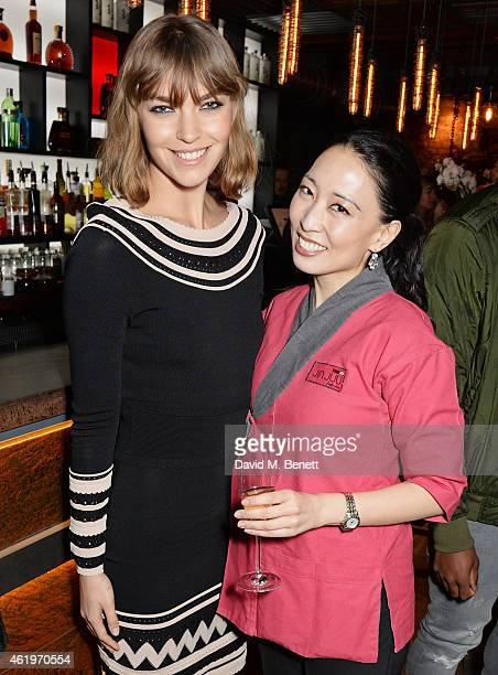 Arizona Muse and Executive Chef Judy Joo attend the Jinjuu launch dinner Kingly Street at Jinjuu on January 22 2015 in London England