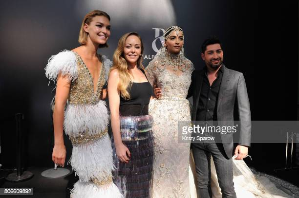 Arizona Muse Tamara Ralph Sonam Kapoor and Michael Russo pose backstage after the Ralph Russo Haute Couture Fall/Winter 20172018 show as part of...