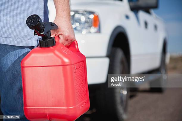 USA, Arizona, Phoenix, Man with canister in front of car