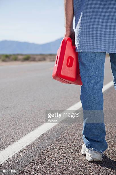 USA, Arizona, Phoenix, Man with canister waiting on road