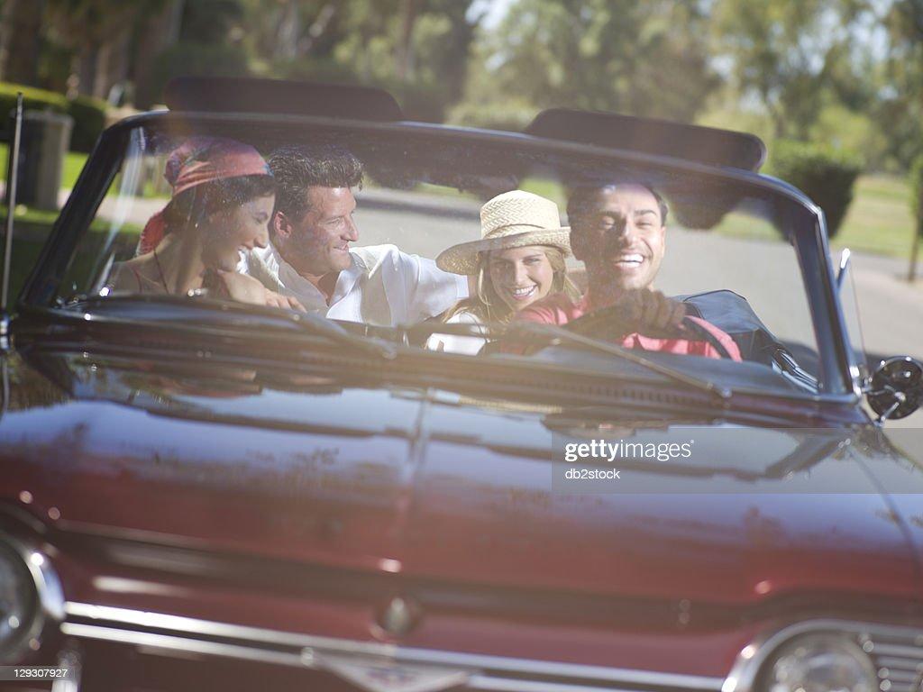 USA, Arizona, Scottsdale, Friends driving convertible car : Stock Photo