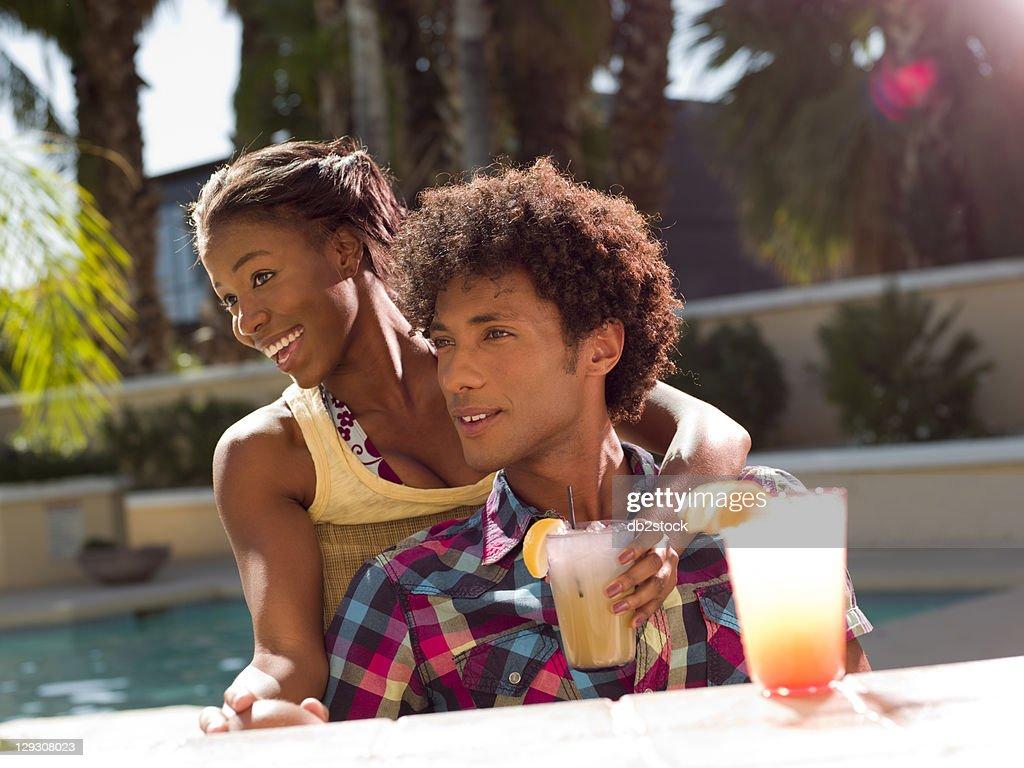 USA, Arizona, Scottsdale, Young couple at pool side bar : Stock Photo