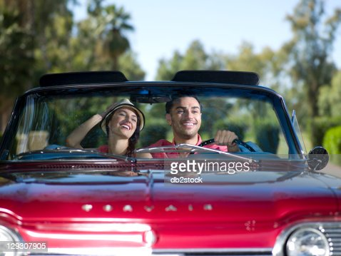 USA, Arizona, Scottsdale, Young couple driving convertible car : Stock Photo