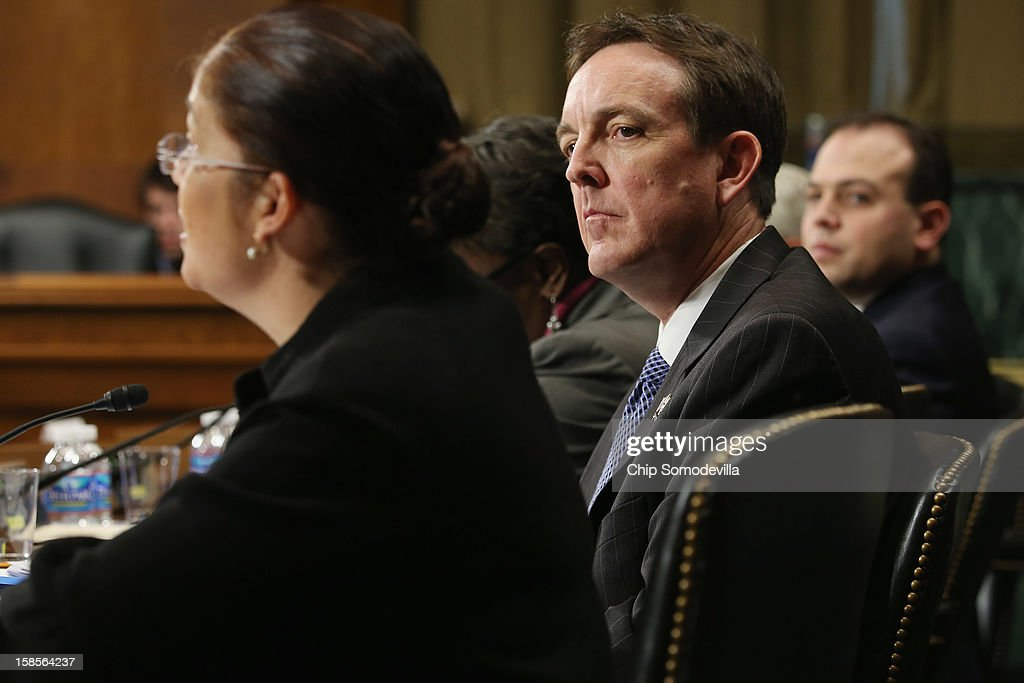 Arizona Secretary of State Ken Bennett (C) listens to Mexican American Legal Defense and Educational Fund Vice President of Litigation Nina Perales (L) as they testify before the Senate Judiciary Committee about voter rights at the Dirksen Senate Office Building on Capitol Hill December 19, 2012 in Washington, DC. According to the committee, the hearing focused on Americans' access to the voting booth 'and the continuing need for protections against efforts to limit or suppress voting.'