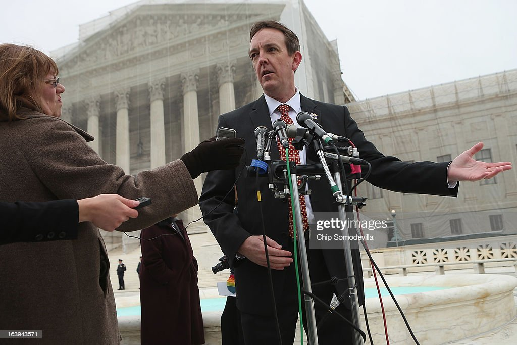 Arizona Secretary of State Ken Bennett (C) talks with reporters outside the U.S. Supreme Court after attending oral arguements in Arizona v. Inter Tribal Council et al. March 18, 2013 in Washington, DC. The court is hearing arguments about the constitutionality of an Arizona law requiring applicants to prove their citizenship before registering to vote under the federal National Voter Registration Act.