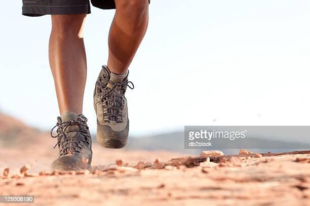 USA, Arizona, Sedona, Hiking boots moving across rocky surface