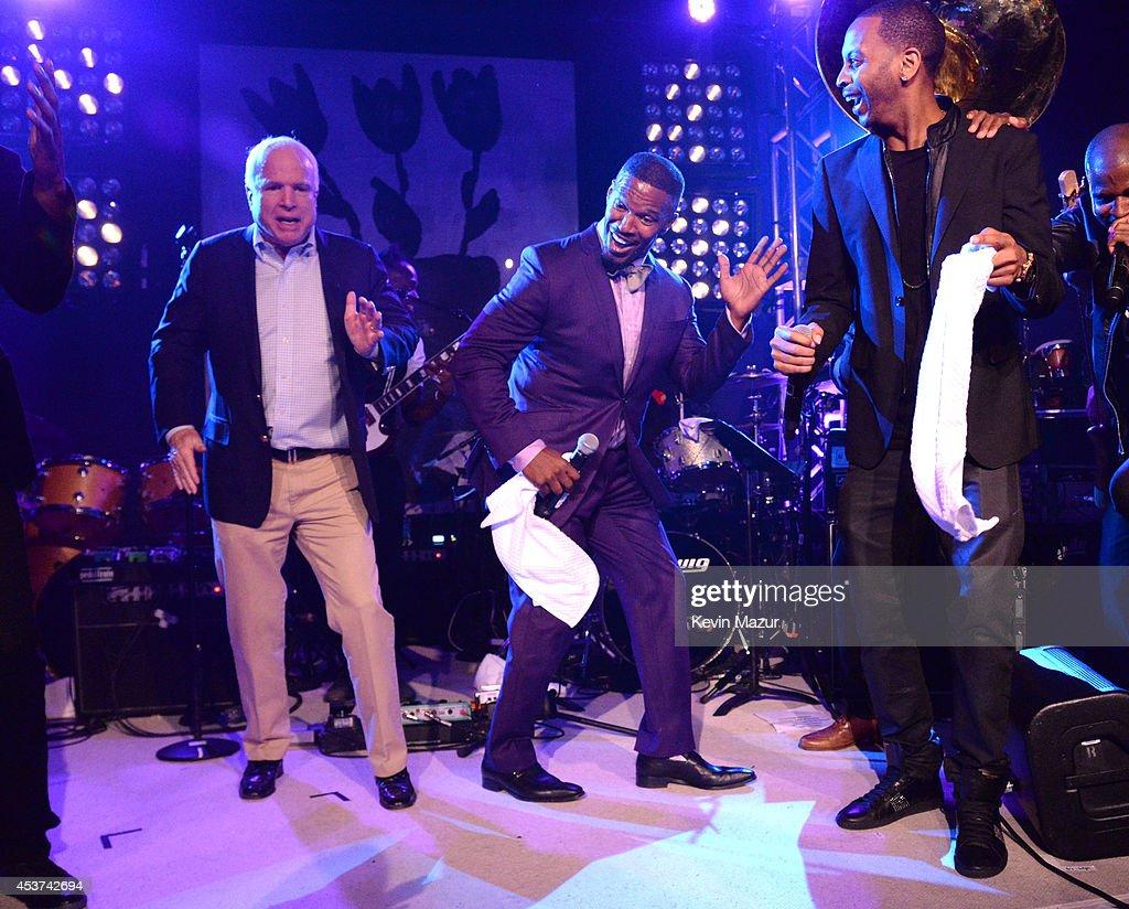 Arizona Senator John McCain and Jamie Foxx dance onstage at Apollo in the Hamptons at The Creeks on August 16 2014 in East Hampton New York