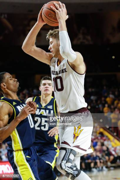 Arizona State Sun Devils forward Vitaliy Shibel drives the lane defended by Northern Arizona Lumberjacks guard Torry Johnson during the college...