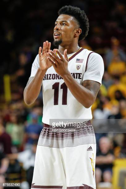 Arizona State Sun Devils guard Shannon Evans II applauds a teammate during the college basketball game between the Northern Arizona Lumberjacks and...