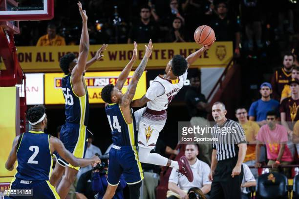 Arizona State Sun Devils guard Shannon Evans II goes up for shot over Northern Arizona Lumberjacks guard Karl Harris and Northern Arizona Lumberjacks...