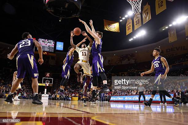 Arizona State Sun Devils guard Shannon Evans II is defended by Washington Huskies forward Sam Timmins during the first half of the college basketball...