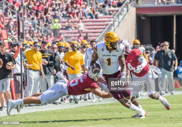 Arizona State Sun Devils wide receiver N'Keal Harry slips by Stanford Cardinal cornerback Alameen Murphy and Stanford Cardinal linebacker Jordan...