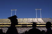 PHOENIX AZ MAY 13 Arizona State University graduate students are silhouetted during their graduation at Sun Devil Stadium May 13 in Tempe Arizona US...