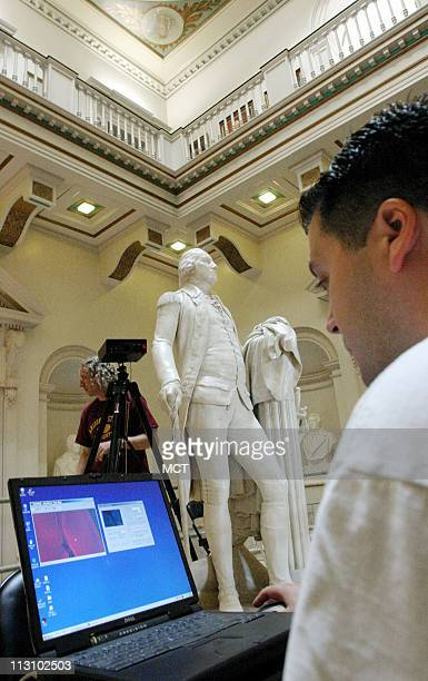 Arizona State University student Matt Tocheri examines data from a 3D scan of Houdon's Washington statue at the Virginia State Capital building in...