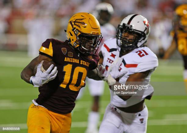 Arizona State wide receiver Kyle Williams fends off a tackle during the Texas Tech Raider's 5245 victory over the Arizona State Sun Devils on...