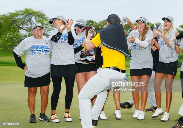 Arizona State's women's golf team celebrates their National Championship with a water bottle shower from the Arizona State men's golf team at the...