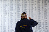 S Arizona survivor Louis Conter salutes the remembrance wall of the USS Arizona during a memorial service for the 73rd anniversary of the attack on...