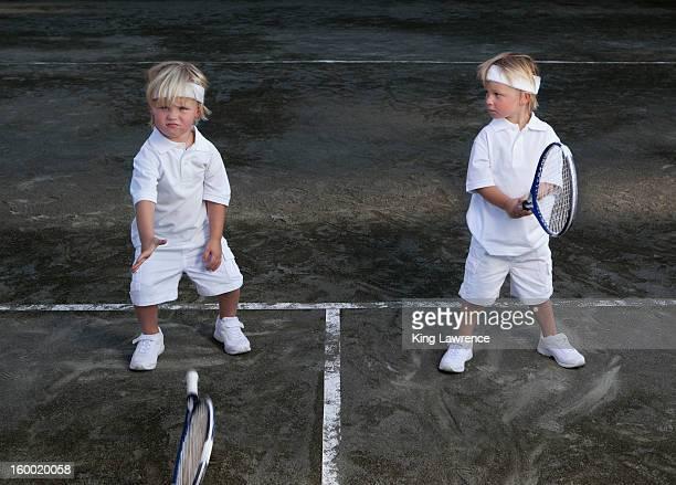 USA, Arizona, Texarkana, Two boys (2-3 years) playing tennis