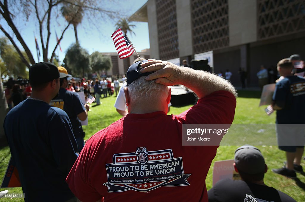 Arizona union supporters gather in support of comprehensive immigration reform outside the Arizona State Capitol building on March 11, 2013 in Phoenix, Arizona. The rally, organized by the AFL-CIO, was the last of a national tour in support of immigration reform which protects workers' rights. Photo by John Moore/Getty Images)