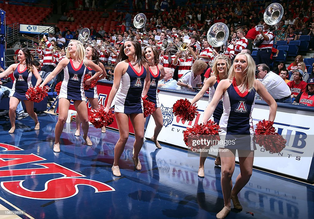 Arizona Wildcats cheerleaders perform during the college basketball game against the Long Beach State 49ers at McKale Center on November 19, 2012 in Tucson, Arizona. The Wildcats defeated the 49ers 94-72.