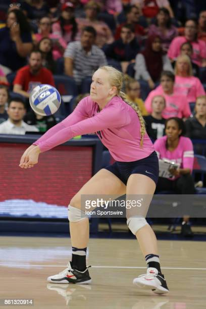 Arizona Wildcats defensive specialist Gabriella Halcovich hits the ball during the a college volleyball game between Utah Utes and Arizona Wildcats...