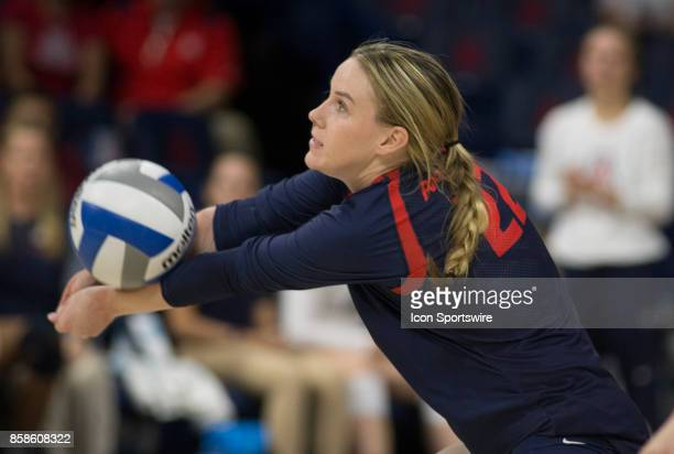 Arizona Wildcats defensive specialist Makenna Martin hits the ball during the a college volleyball game between USC Trojans and Arizona Wildcats on...