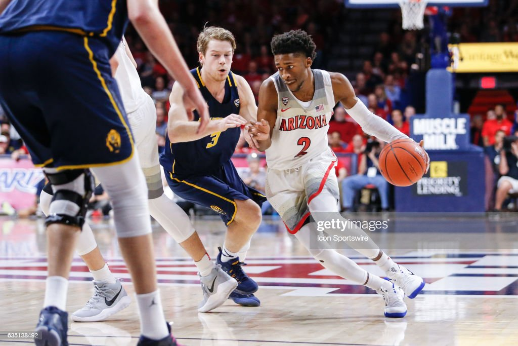 Arizona Wildcats guard Kobi Simmons (2) drives to the basket defended by California Golden Bears guard Grant Mullins (3) during the college basketball game between the Cal Golden Bears and the Arizona Wildcats on February 11, 2017 at Mckale Center in Tucson, Arizona.