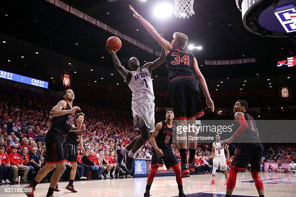 Arizona Wildcats guard Rawle Alkins shoots over Utah Utes forward Jayce Johnson during the second half of the NCAA college basketball game at McKale...
