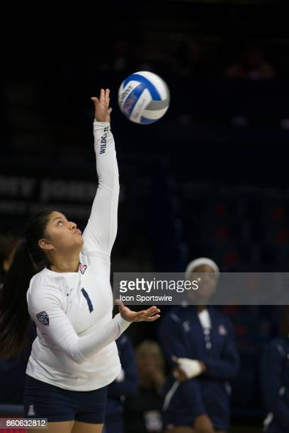 Arizona Wildcats libero/defensive specialist Kimberly Gutierrez serves the ball during the a college volleyball game between USC Trojans and Arizona...
