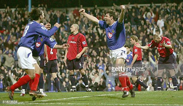 Arjan De Zeeuw of Porstmouth celebrates scoring the equilizer during the Barclays Premiership match between Portsmouth and West Bromwich Albion at...