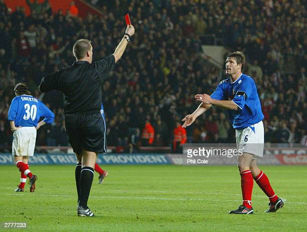 Arjan De Zeeuw of Portsmouth appeals with referee Graham Poll as he sends him off during the Carling Cup fourth round match between Southampton and...