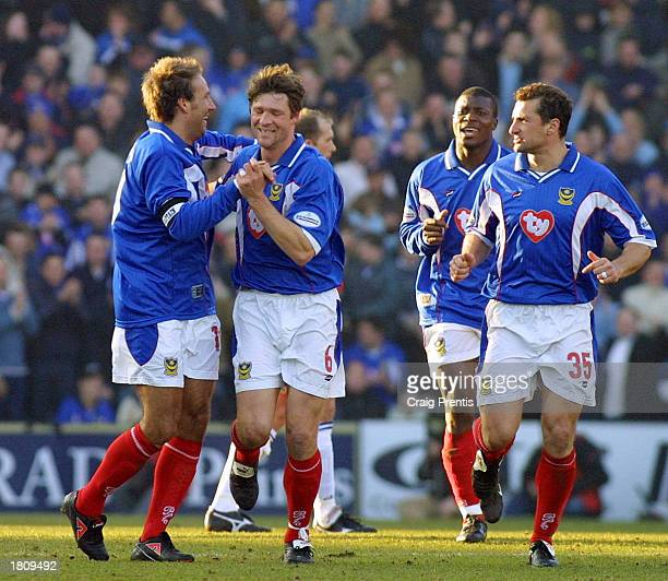 Arjan de Zeeuw of Portsmouth celebrates with Paul Merson during the Nationwide League Division One match between Portsmouth and Gillingham at Fratton...