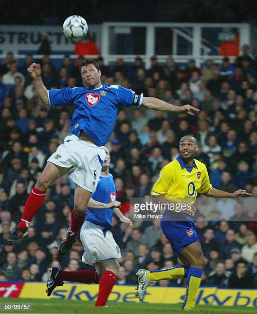 Arjan De Zeeuw of Portsmouth wins a header from Thierry Henry of Arsenal during the FA Barclaycard Premiership match between Portsmouth and Arsenal...