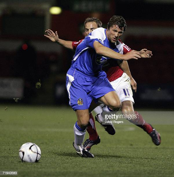 Arjan de Zeeuw of Wigan cuts in front of David Vaughan during the Carling Cup second round match between Crewe Alexandra and Wigan Athletic at the...