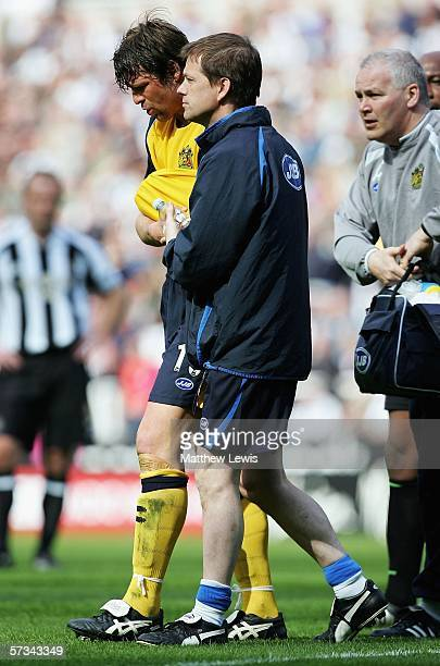 Arjan De Zeeuw of Wigan goes off after gettting injured during the Barclays Premiership match between Newcastle United and Wigan Athletic at StJames'...