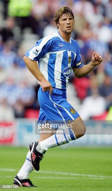 Arjan De Zeeuw of Wigan in action during the Barclays Premiership match between Wigan Athletic and Chelsea on August 14 2005 in Wigan England