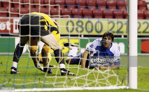 Arjan De Zeeuw of Wigan looks on at his back pass to Chris Kirkland during the Barclays Premiership match between Wigan Athletic and Sheffield United...