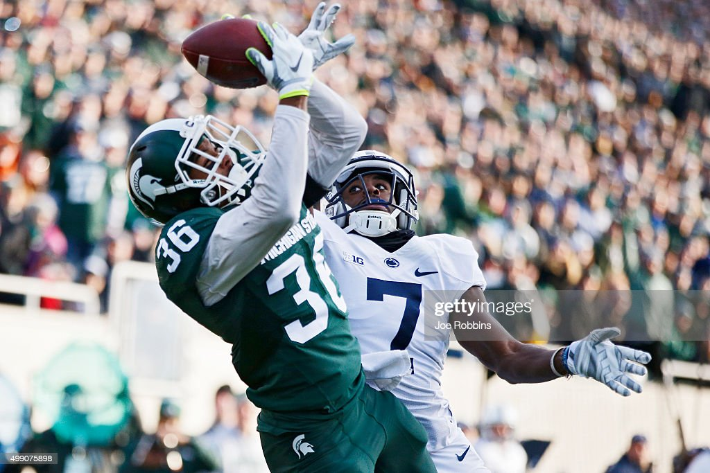 Arjen Colquhoun #36 of the Michigan State Spartans makes an interception in the end zone of a pass intended for Geno Lewis #7 of the Penn State Nittany Lions in the first half of the game at Spartan Stadium on November 28, 2015 in East Lansing, Michigan.
