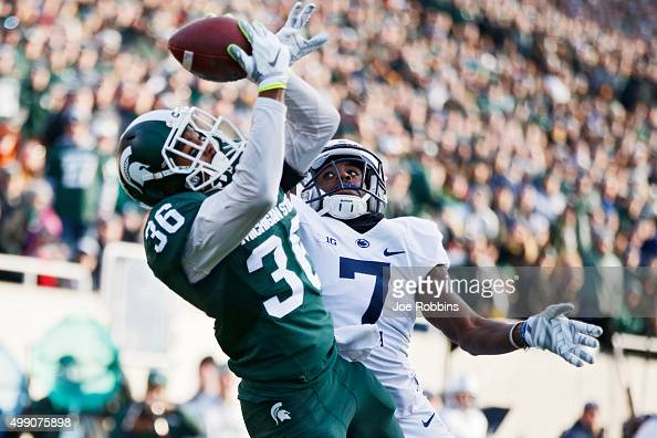 Arjen Colquhoun of the Michigan State Spartans makes an interception in the end zone of a pass intended for Geno Lewis of the Penn State Nittany...