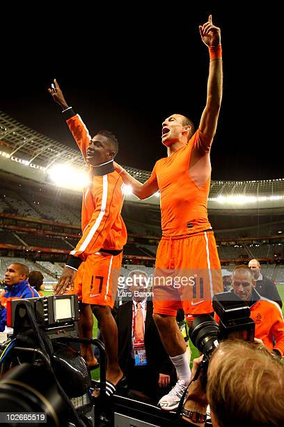 Arjen Robben and Eljero Elia of the Netherlands celebrate victory and a place in the final following the 2010 FIFA World Cup South Africa Semi Final...