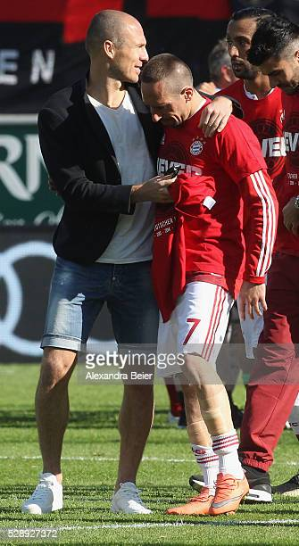 Arjen Robben and Franck Ribery of Bayern Muenchen celebrate their German Championship title after the Bundesliga match between FC Bayern Muenchen and...