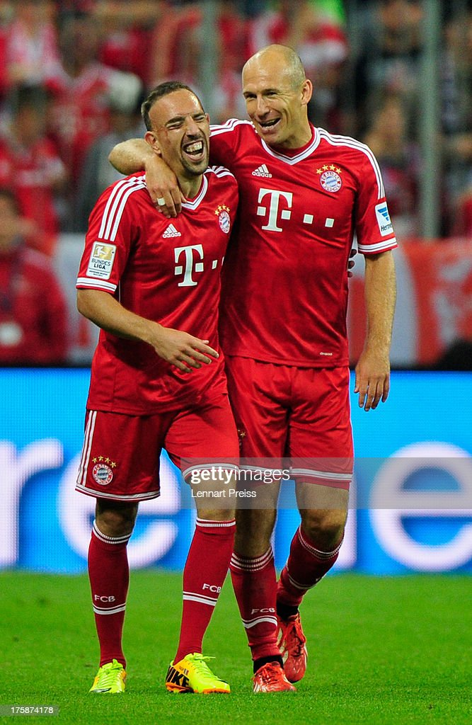 Arjen Robben and Franck Ribery of Muenchen celebrate the opening goal during the Bundesliga match between FC Bayern Muenchen and Borussia...