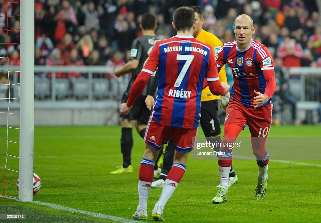 Arjen Robben and Franck Ribery of Muenchen celebrate the opening goal during the Bundesliga match between FC Bayern Muenchen and SC Freiburg at...