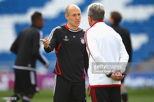 Arjen Robben and head coach Jupp Heynckes of FC Bayern Muenchen attend training session on the eve of their UEFA Champions League semifinal second...