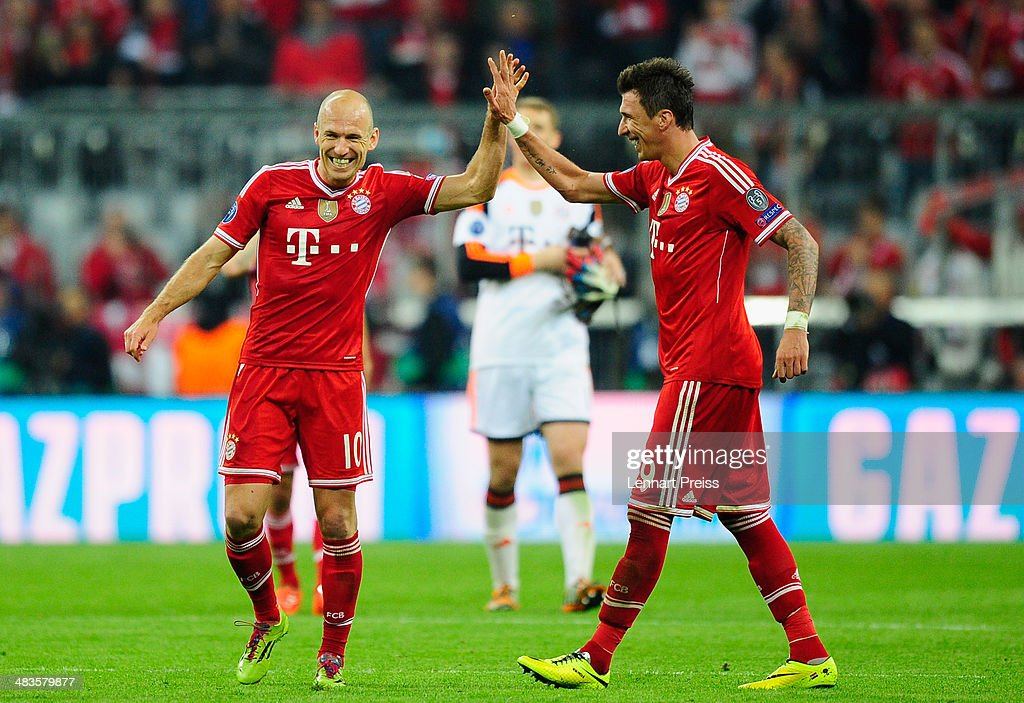 Arjen Robben (L) and Mario Mandzukic of Muenchen celebrate the victory after the UEFA Champions League quarter-final second leg match between FC Bayern Muenchen and Manchester United at Allianz Arena on April 9, 2014 in Munich, Germany.